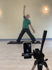 Filming a yoga pose